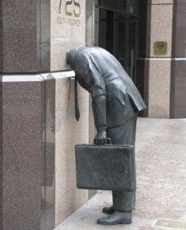 corporate head statue