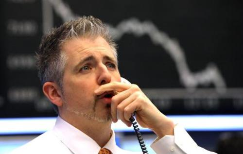 German stock exchange, stock market crash. A trader reacts after the news of
