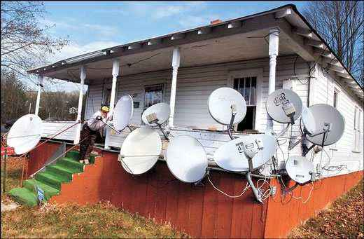 Al Jessup, his satellite dishes and 5,000 channels